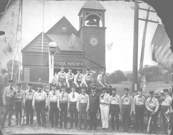 The firemen of Cliffside Hose Number 4 pose for a picture outside of the firehouse, sometime between 1889 and 1904