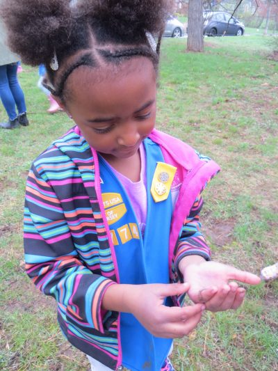 Young girl holding an earthworm
